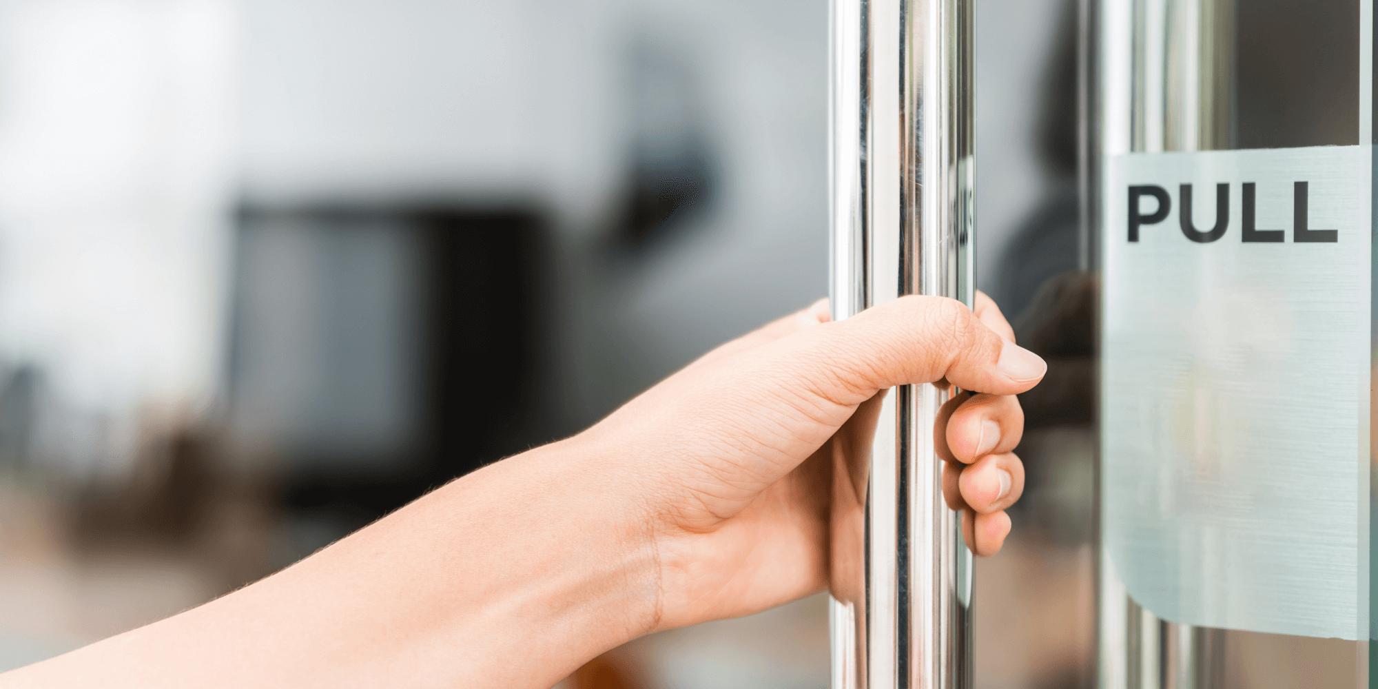 Banner image - hand pulling open a glass door.